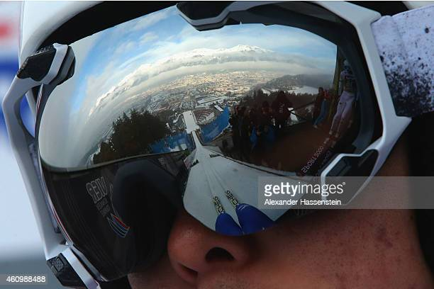 A reflection of the Alps mountain 'Nordkette' is seen in the ski googles of Junshiro Kobayashi of Japan as he prepares for a trial jump during day 5...