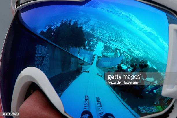 A reflection of the Alps mountain 'Nordkette' is seen in the ski googles of Marinus Kraus of Germany as he prepares for a trial jump during day 5 of...