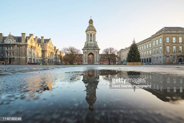 a reflection of the campanile in trinity college, dublin city, ireland - dublin stock pictures, royalty-free photos & images