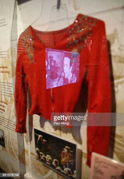 A reflection of The Clash's Joe Strummer on the glass case encasing a jacket worn by Rolling Stones guitarist Keith Richards at the 1969 Altamont...