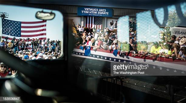 Reflection of the crowd and media coverage through a tractor cab while Republican nominee for President Governor Mitt Romney spoke at a rally in...