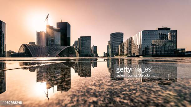 reflection of the defense seen from the grande arche, courbevoie, france - hauts de seine stock pictures, royalty-free photos & images