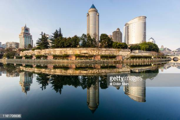 reflection of the guiyang business district in china - guiyang stock pictures, royalty-free photos & images