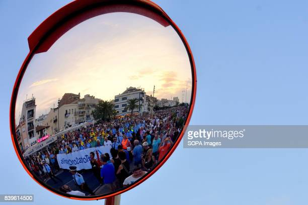 Reflection of the head of the demonstration by the victims of the terrorist attacks in Barcelona and Cambrils held in the city of Cambrils Tarragona...