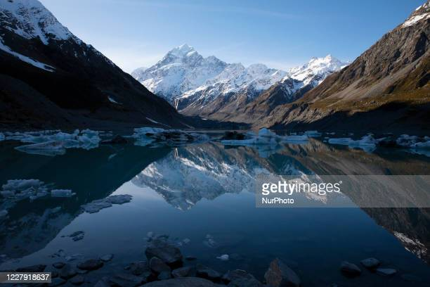 Reflection of the highest mountain in New Zealand Mount Cook also known as Aoraki is seen in the Hooker Lake at Aoraki / Mount Cook National Park in...