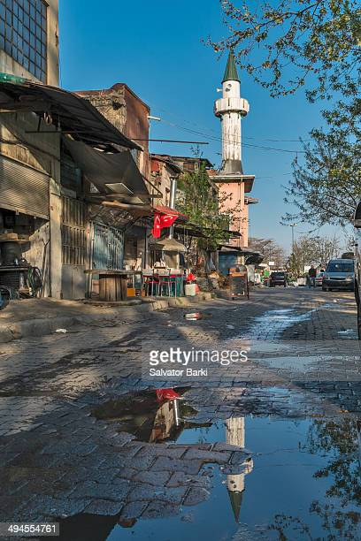 CONTENT] Reflection of the minaret of the Rustem Pasha Mosque and old Ottoman imperial mosque reflected in a paddle of water in Karakoy Istanbul