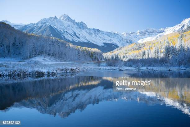reflection of the mountain sneffle range, colorado - aspen colorado stock photos and pictures