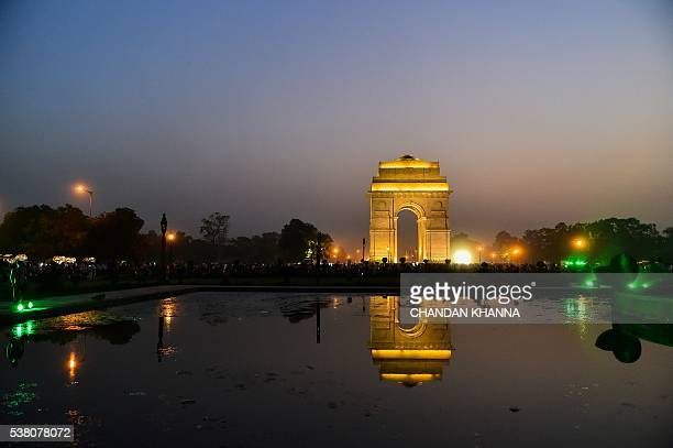 Reflection of the Tomb Of The Unknown Soldier at India Gate is seen in a pond in New Delhi on June 4 2016 / AFP / CHANDAN KHANNA