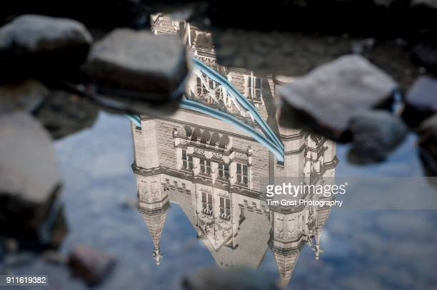 Reflection of Tower Bridge in a Pool of Water