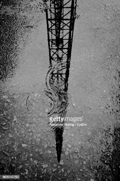Reflection Of Tower In Puddle