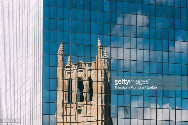 Reflection Of Tower On Glass Building