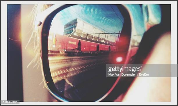 Reflection Of Train On Sunglasses