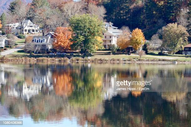 reflection of trees and buildings in lake - asheville stock pictures, royalty-free photos & images