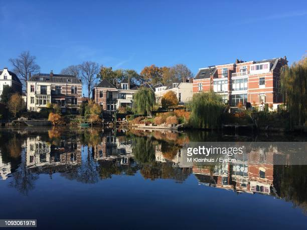 reflection of trees and buildings in lake - zwolle stock pictures, royalty-free photos & images