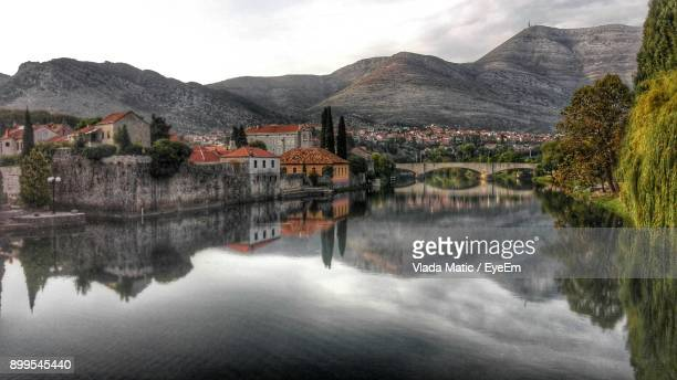 Reflection Of Trees And Buildings In Water