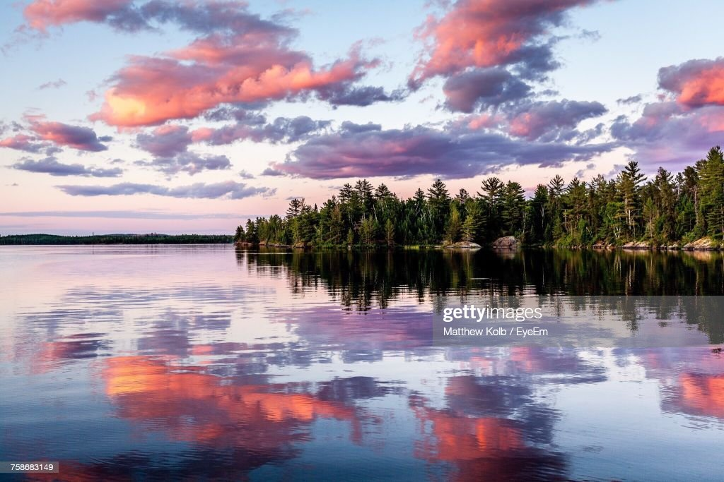 Reflection Of Trees In Lake Against Sky During Sunset : Stock Photo
