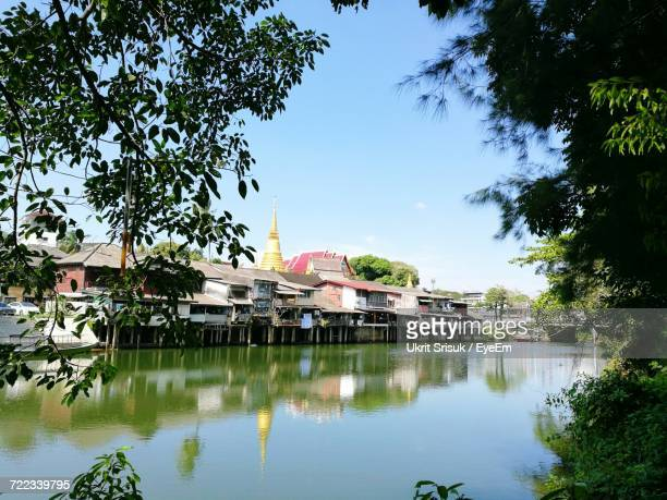 reflection of trees in lake against sky - chanthaburi stock pictures, royalty-free photos & images