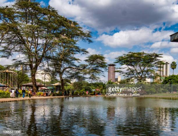 reflection of trees in lake - nairobi stock pictures, royalty-free photos & images