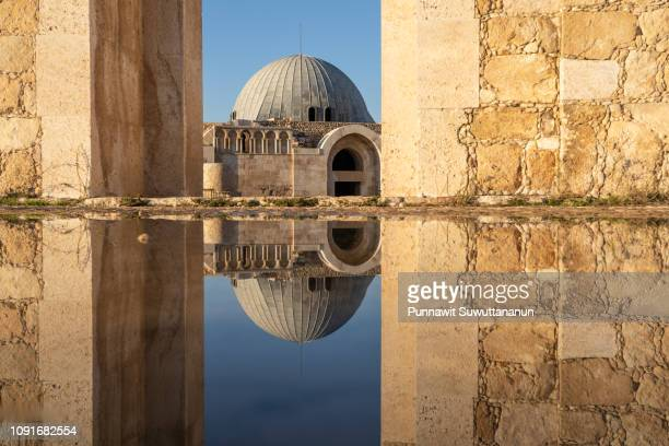 reflection of umayyad mosque, roman ancient city in amman capital city of jordan - jordan middle east stock pictures, royalty-free photos & images