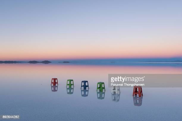 reflection of uyuni at sunrise, bolivia - horizon over land stock photos and pictures