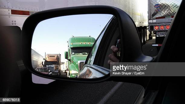 Reflection Of Vehicles On Side-View Mirror