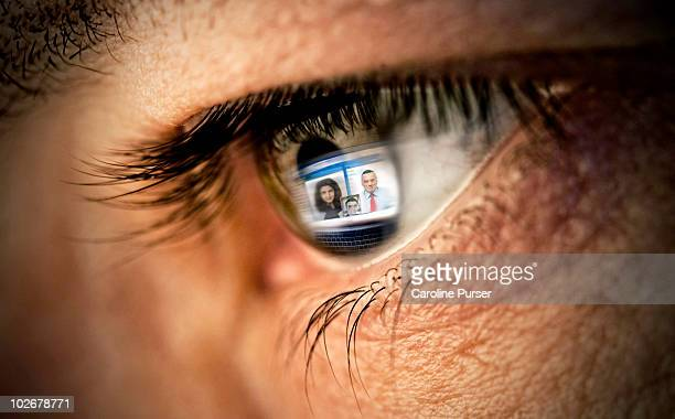 Reflection of video conference on computer in eye