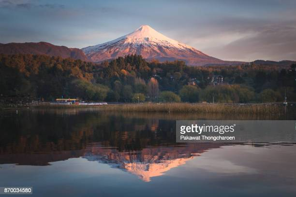 reflection of villarrica volcano at sunset, pucon, chile - villarrica stock photos and pictures