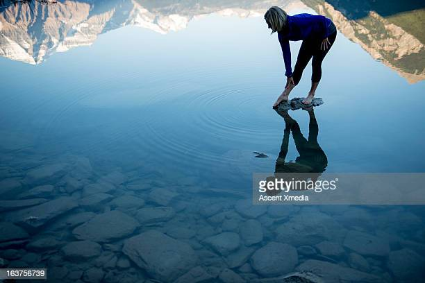 Reflection of woman doing stretching exercises, mt