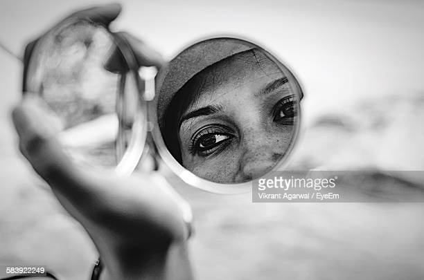 Reflection Of Woman Face On Hand Mirror