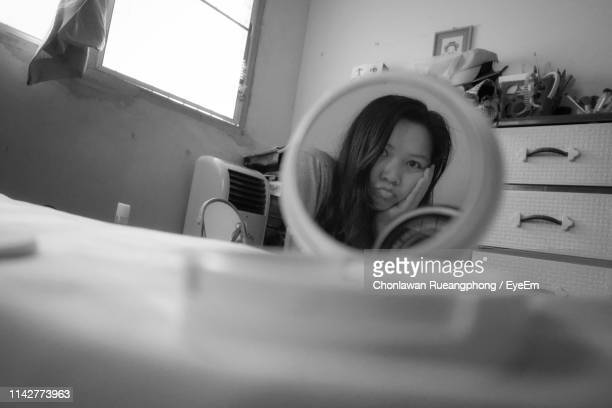 Reflection Of Woman In Mirror At Home