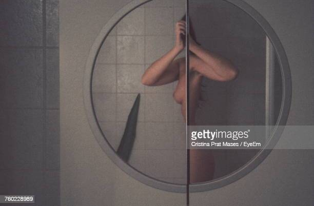 Reflection Of Woman In Mirror