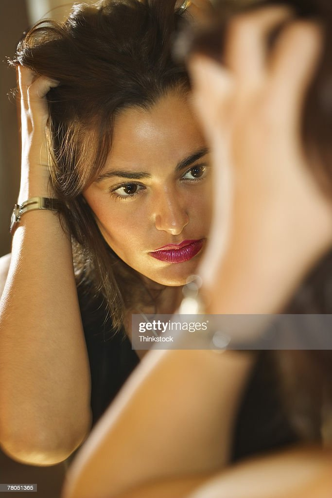 Reflection of woman in mirror : Stock Photo