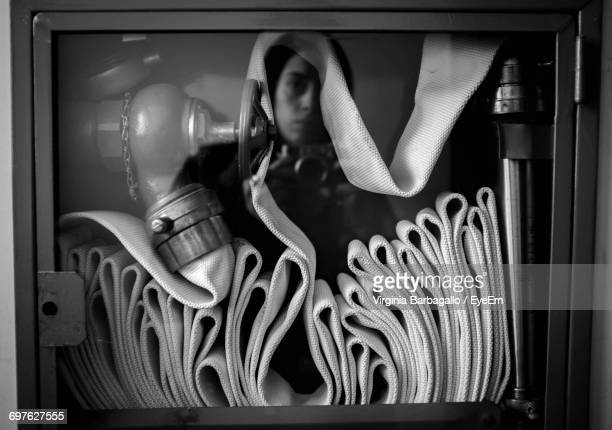 Reflection Of Woman On Glass With Fire Hose