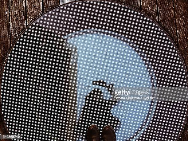 Reflection Of Woman On Hatch Glass Of Yacht