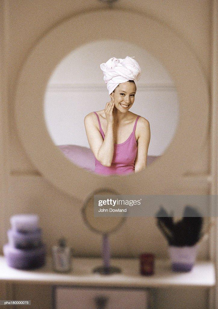 Reflection of woman on mirror : Stockfoto