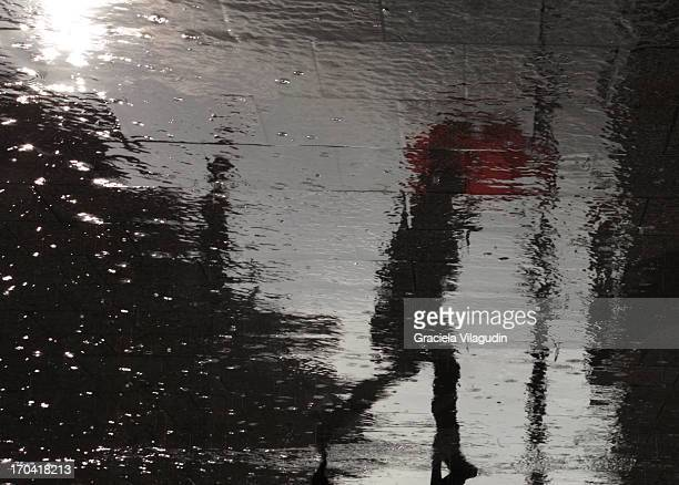 Reflection of woman with red umbrella