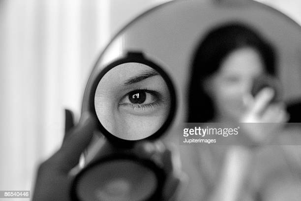 Reflection of woman's eye in mirror