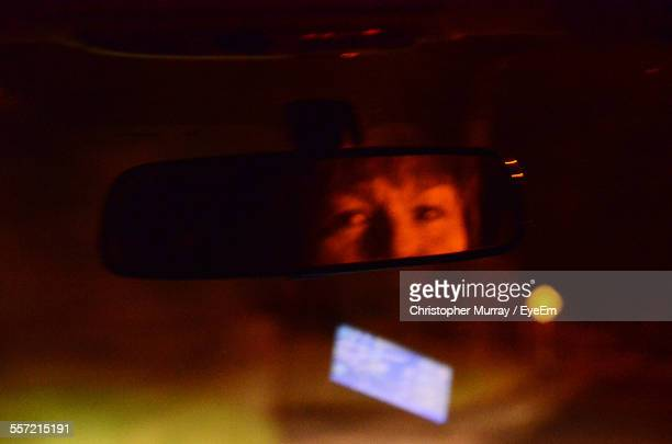 Reflection Of Women In Car Rear View Mirror