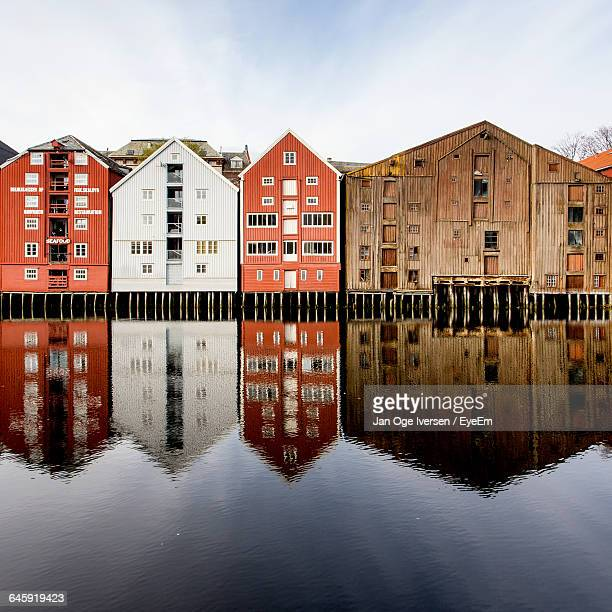 Reflection Of Wooden Warehouses In River
