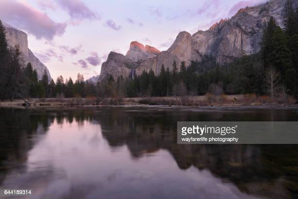 Reflection of Yosemite Valley at pink sunset, California
