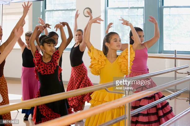 Reflection of young girls in dance class