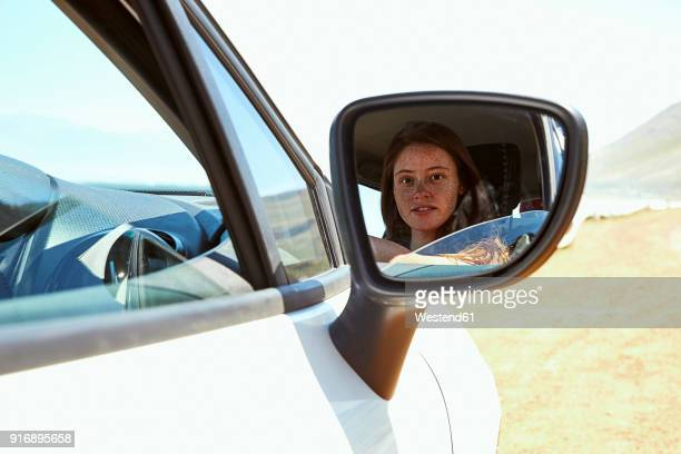 reflection of young woman in wing mirror of a car - side view mirror stock photos and pictures