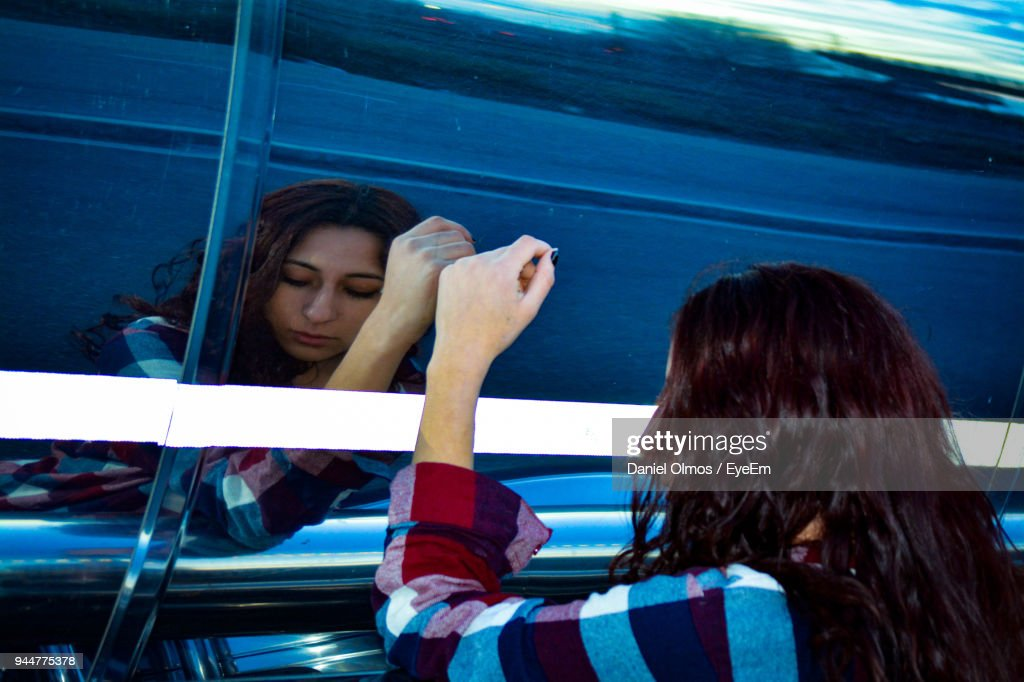 Reflection Of Young Woman On Vehicle : Stock Photo