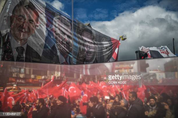 TOPSHOT A reflection on a election bus window shows supporters of Justice and development Party on March 29 2019 during an election rally in Istanbul...