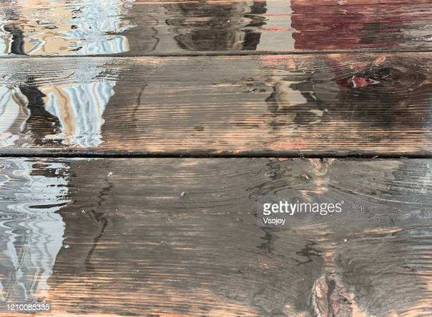 reflection on a wooden table, denmark - vsojoy stock pictures, royalty-free photos & images