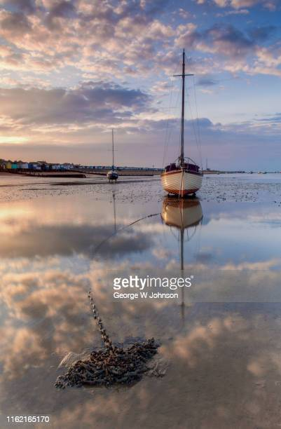 reflection on chains - nautical vessel stock pictures, royalty-free photos & images