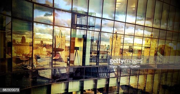 reflection on glass window of building - maria tejada stock pictures, royalty-free photos & images