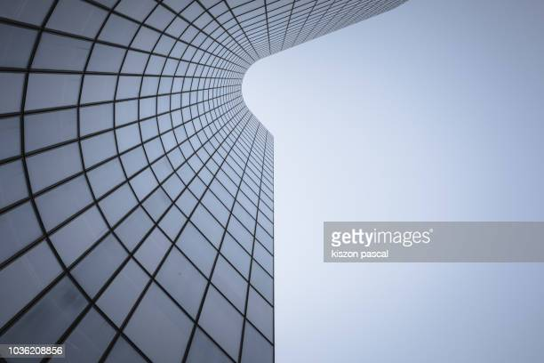 reflection on office building glass windows with curve lines. - architecture stock pictures, royalty-free photos & images
