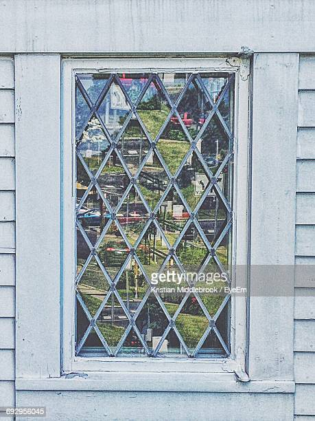 Reflection On Patterned Window Glass Of Church