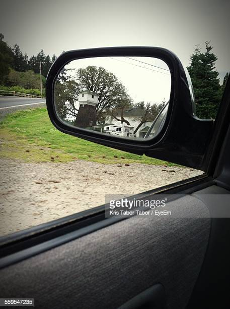 Reflection On Side View Mirror Of Car